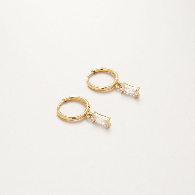 New in: Icon Hoops, the perfect sleek huggies with a baguette-cut zirconia stone
