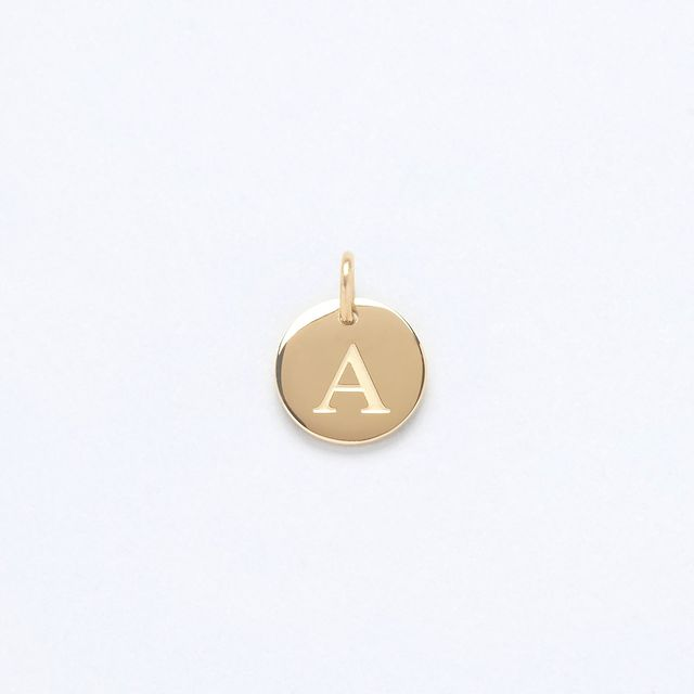 A classic, our gold Letter charm