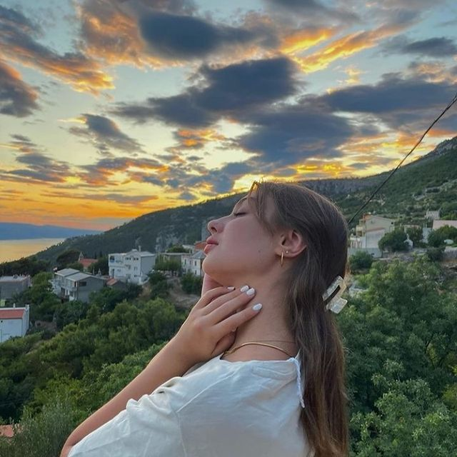 @denisekertes soaking up the beautiful sunset with her favourite jewellery